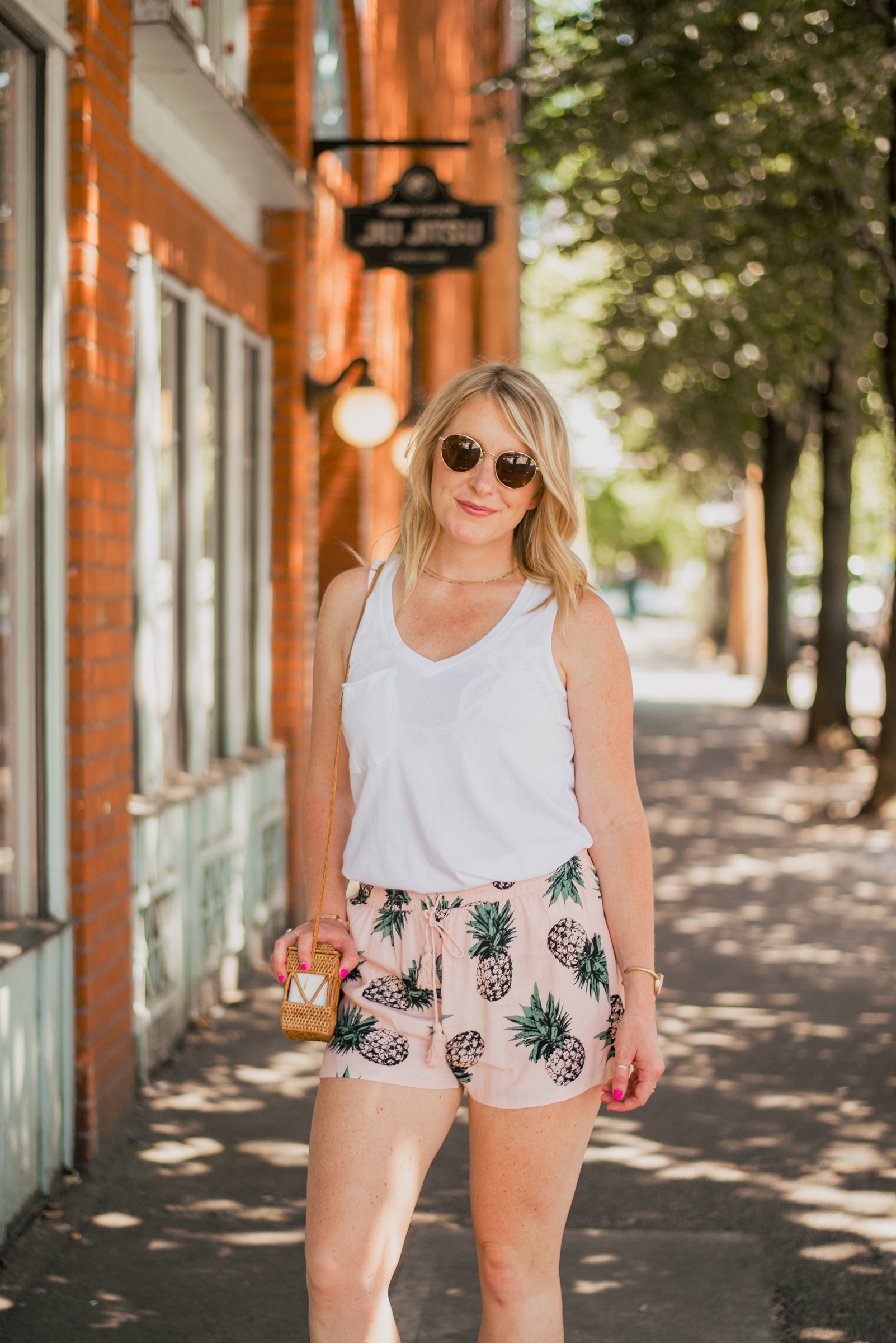 Learn the Basics of Photography - Woman wearing white tank top and pineapple patterned shorts