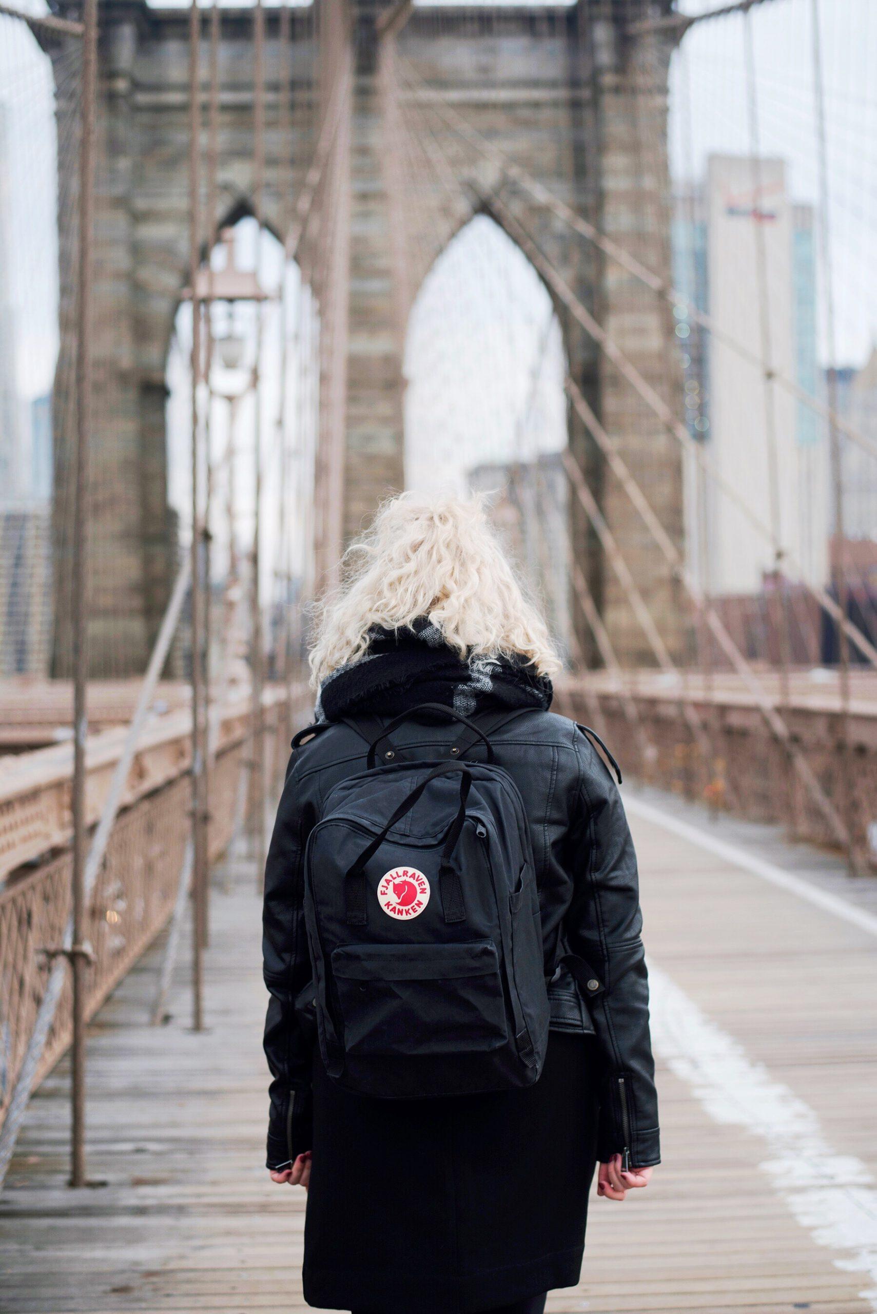 Fjallraven black laptop backpack camera bag on the Brooklyn Bridge