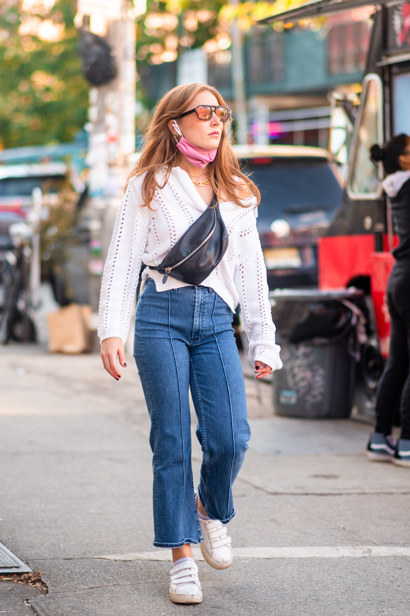 NYC street style fall outfit idea - woman wearing light weight white sweater, straight leg jeans, and cross body bag - Karya Schanilec NYC fashion photographer