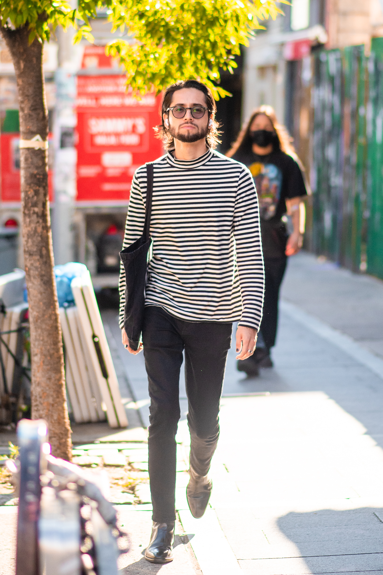 NYC street style fall outfit idea - man wearing striped turtleneck in Parsian style - Karya Schanilec NYC fashion photographer