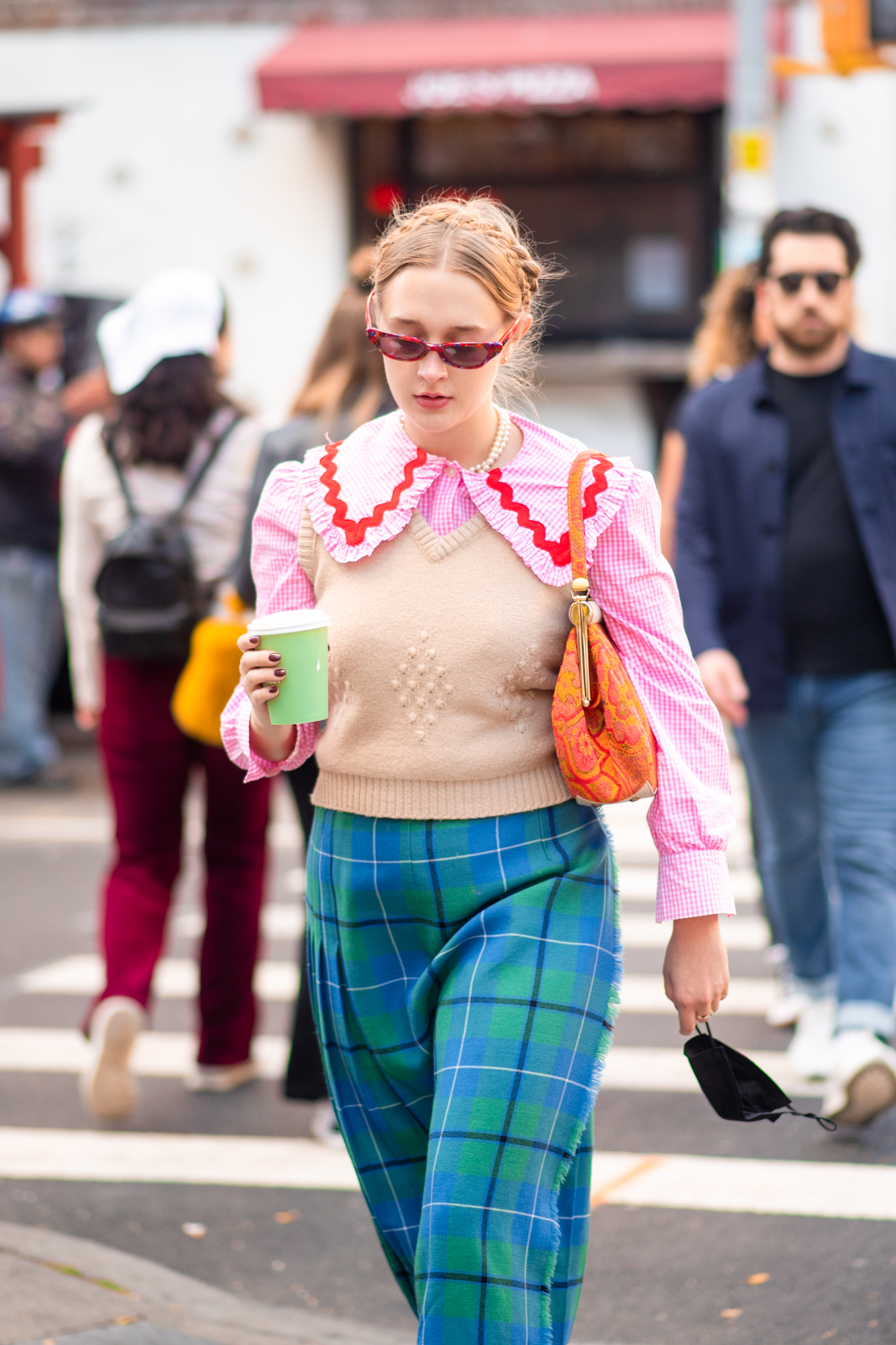 NYC street style fall outfit idea - woman wearing eccentric maximalist outfit for fall - Karya Schanilec NYC fashion photographer