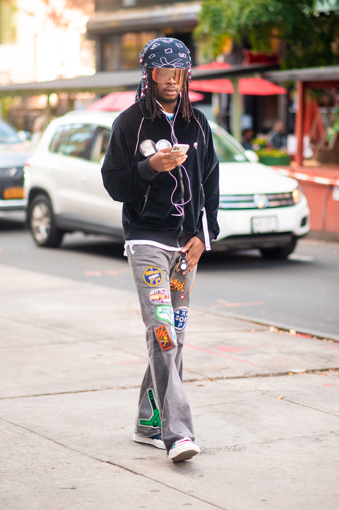 NYC street style fall outfit idea - man wearing jeans with patches - Karya Schanilec NYC fashion photographer