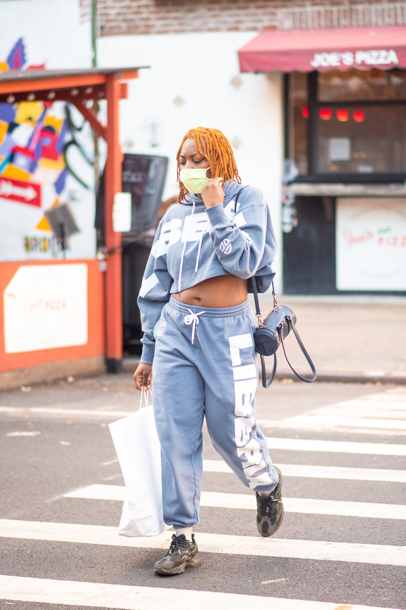 NYC street style fall outfit idea - woman wearing matching sweatsuit set- Karya Schanilec NYC fashion photographer
