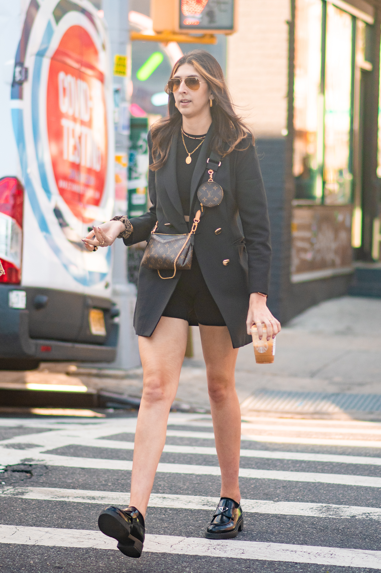 NYC street style fall outfit idea - woman wearing blazer outfit with Louis Vuitton purse set - Karya Schanilec NYC fashion photographer