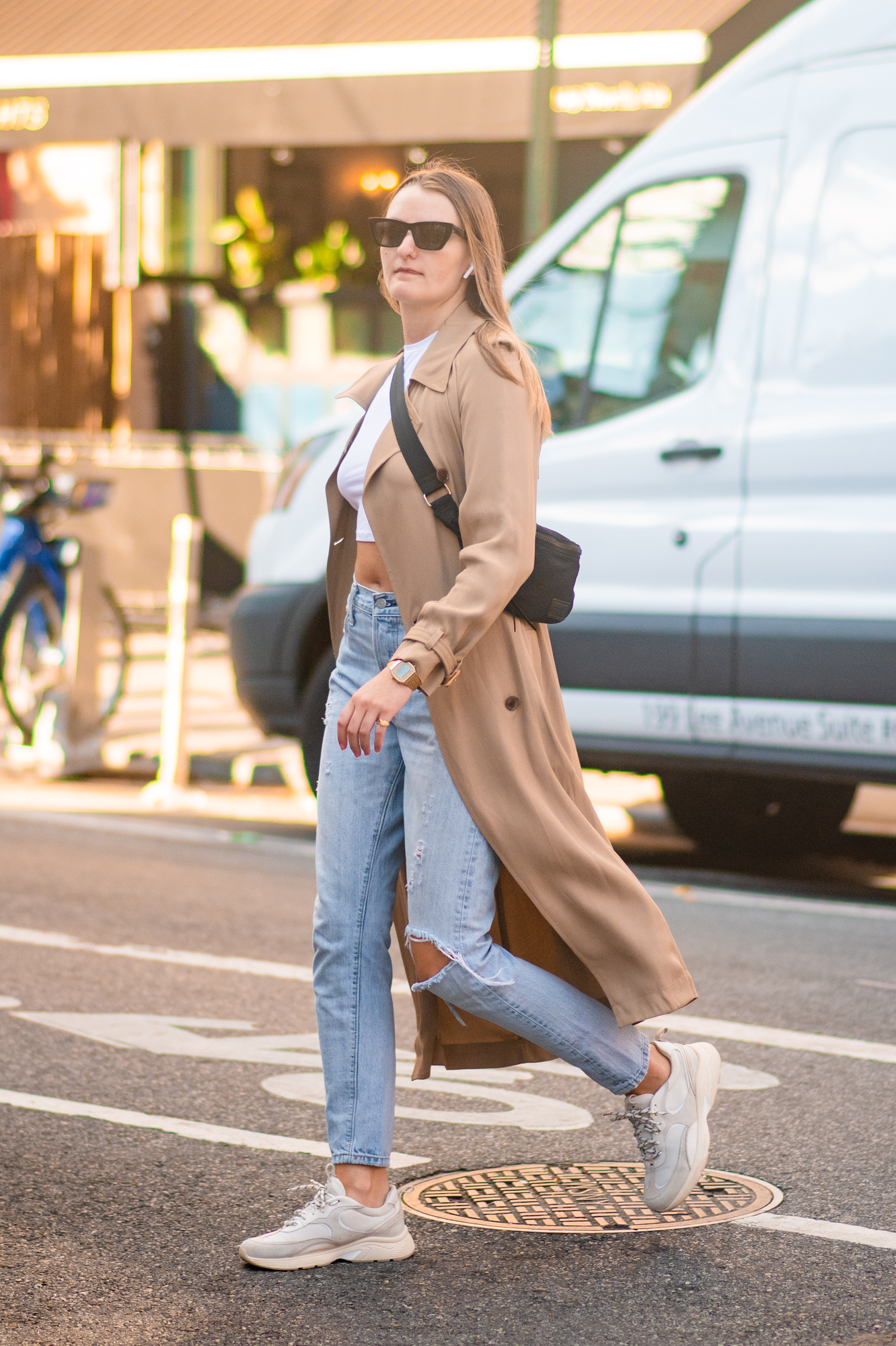 NYC street style fall outfit idea - woman wearing tan trench coat and straight leg jeans- Karya Schanilec NYC fashion photographer