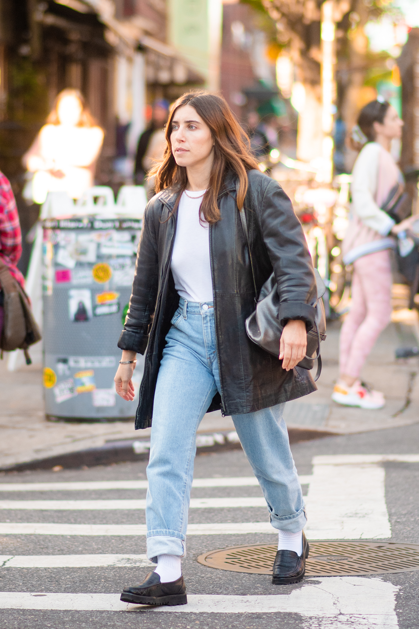 NYC street style fall outfit idea - woman wearing oversized leather blazer, white t shirt, and straight leg jeans outfit - Karya Schanilec NYC fashion photographer